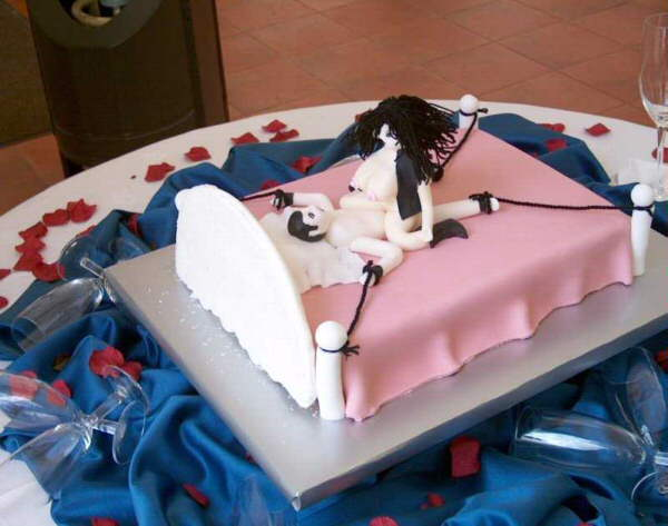 A decorated cake illustrating bedroom bondage.